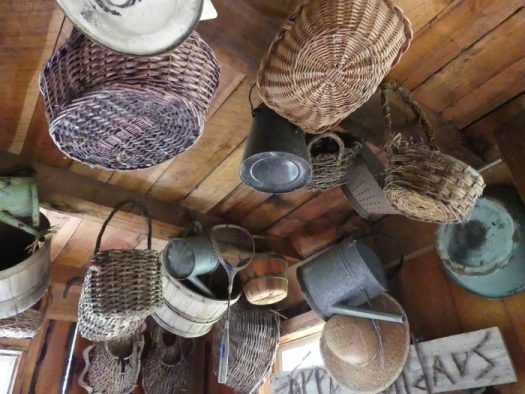 Collection of baskets hanging from a shed's rafters