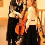 Mom and Jayme getting Reggie the cello set-up (Verndale Alliance Church)