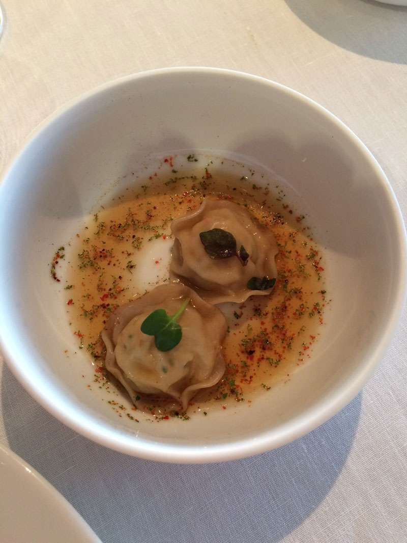 Pasta stuffed with red crayfish with velvet crab consommé