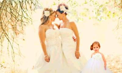Lesbian Mother's and their daughter at their wedding celebration