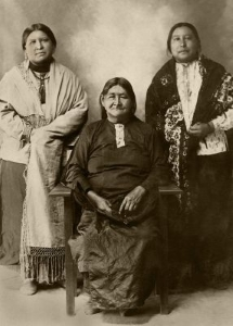 Anna Brown (l) and Molly Burkhart (r) with their mother, Lizzie. Lizzie was poisoned soon after Anna's murder.