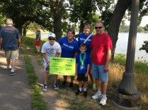 Jeffrey, Jill, John, Me and Grandpa at the Team John sign on the walk path.