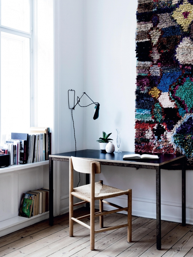 colorful hanging rug above desk - wall art idea