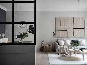 nordic style living room with a hanged rug in the back