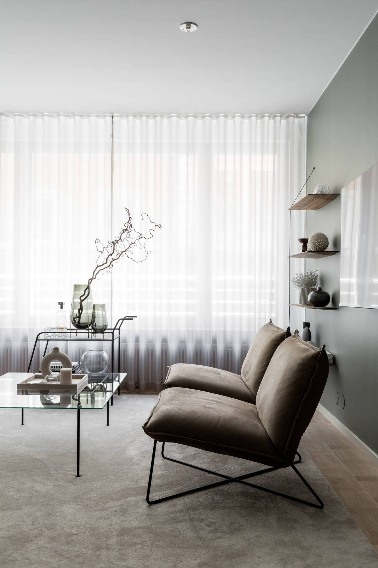 sage green walls living room arm chairs