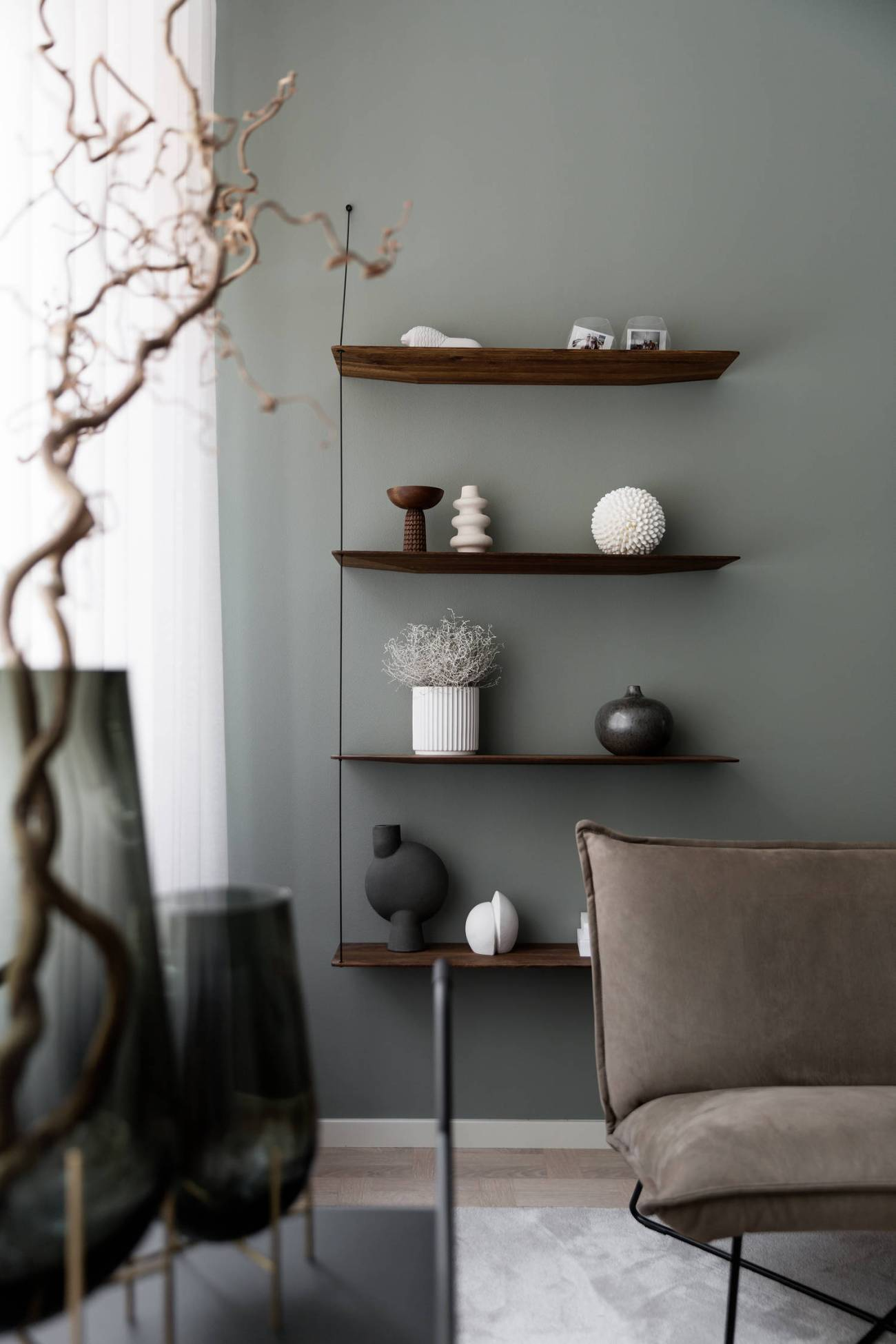 sage green walls living room shelves