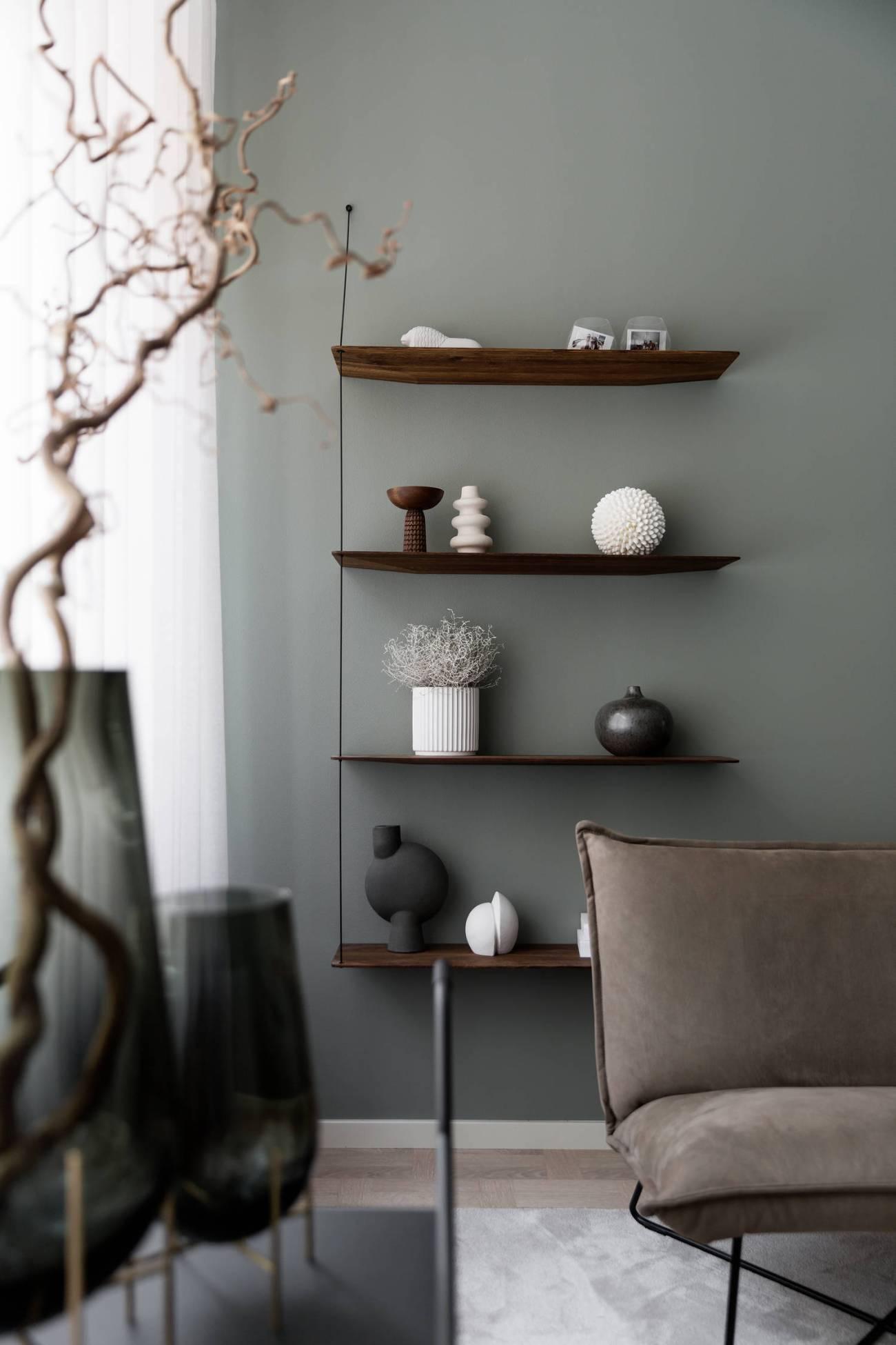 sage green walls living room shelves