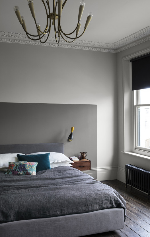 white bedroom with a grey headboard painted on the wall