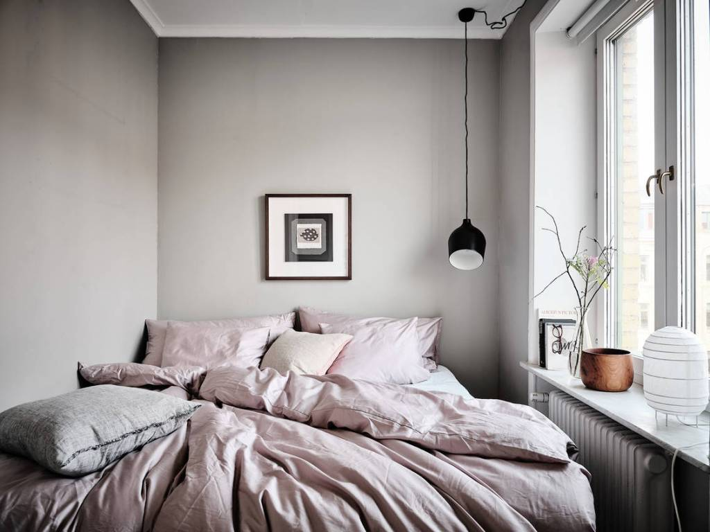 small bedroom with hanging light