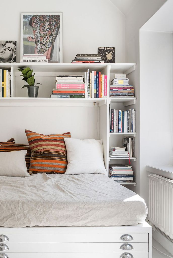 small bedroom with shelving system