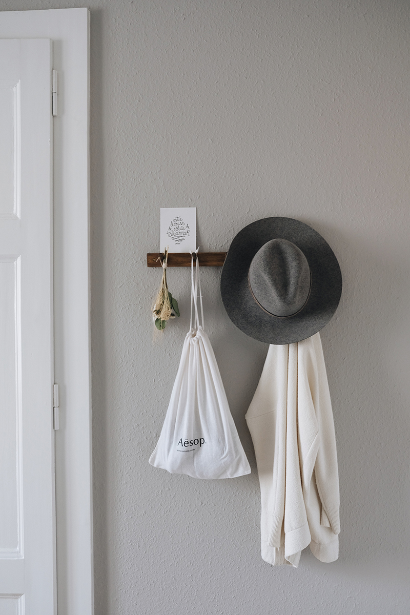 a styled peg rail in a bedroom