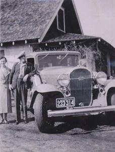 COSTELLO, John & Mary by his car