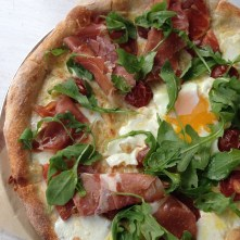 http://instagram.com/p/vd-TBrITns/?modal=trueSpecial Pie of the day has Proscuitto, Heirloom Tomatoes, Mozzarella, Fontina, Farm Egg an Arugula! #goldentcrust #crispy #woodfireoven #butthateggtho 142 likes