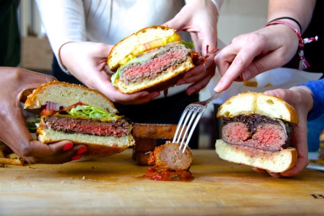 TGHG team getting handsy with our burgers.