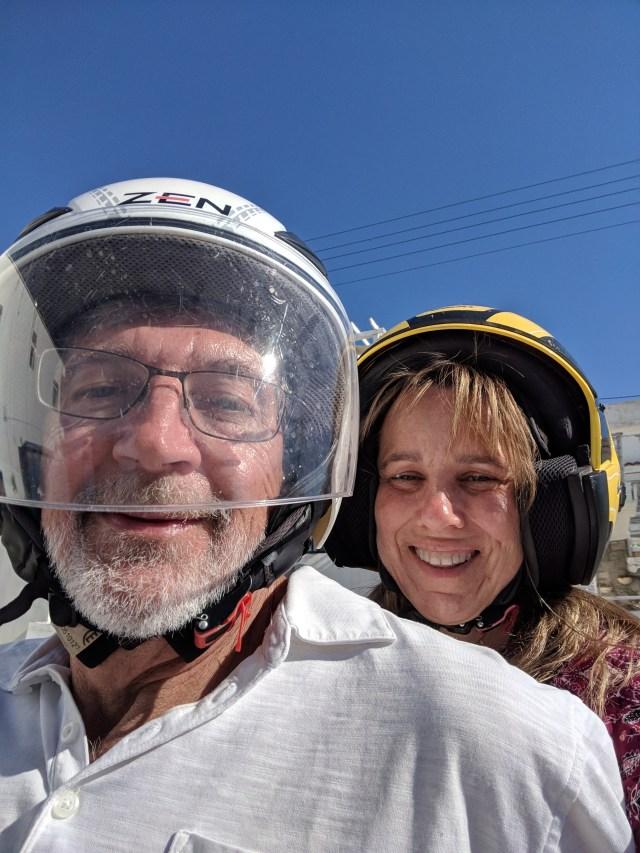 Man and woman ready to explore Milos, Greece on ATV