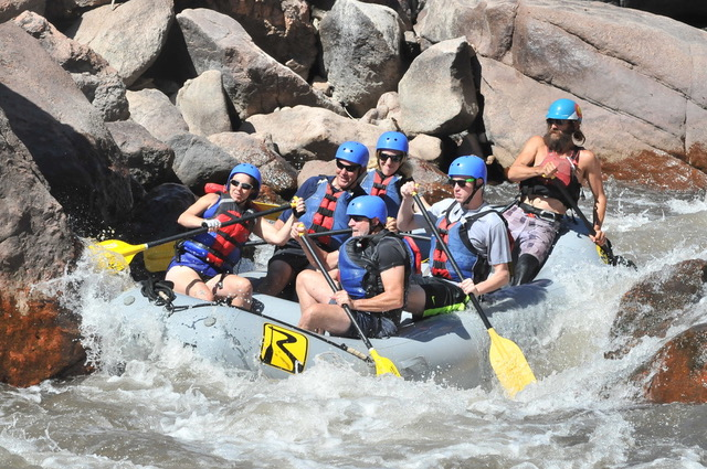 White water rafters in river in Colorado taking time off from a road trip.