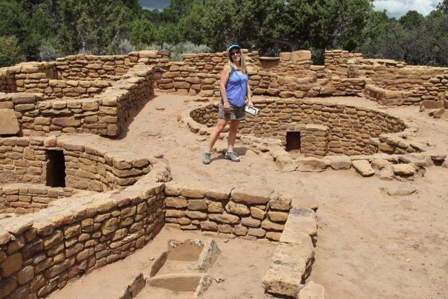 Woman standing in Mesa Verde ruins.