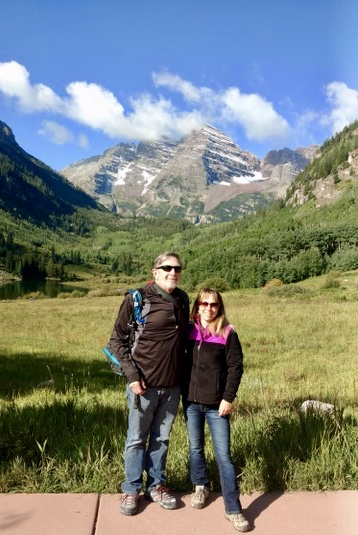 Couple in front of mountains on road trip to Colorado