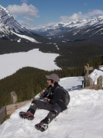 K at the viewpoint, with ice & snow-covered Peyto Lake down in the valley