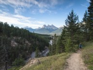 Looking back towards the Three Sisters from the trail through the forest