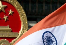 Indian national flag and the Chinese national emblem
