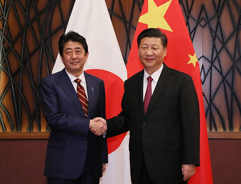Shinzo Abe and President Xi Jinping
