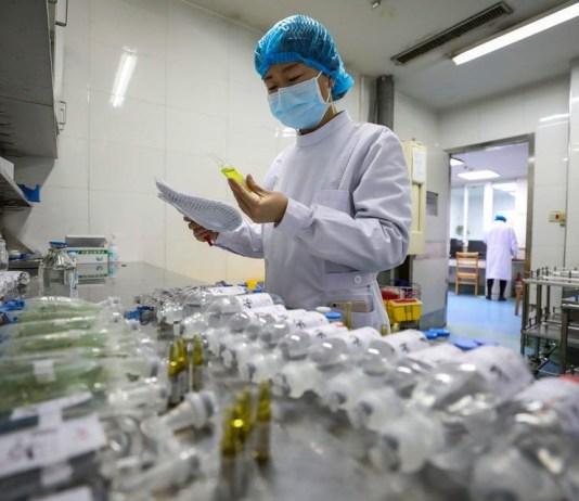A nurse prepares medicine for coronavirus patients
