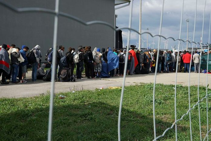 Syrian refugees crossing the border of Hungary and Austria