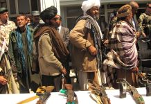 Former Taliban fighters line up to handover their Rifles to the Government of the Islamic Republic of Afghanistan