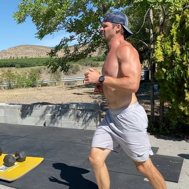 Joe running with backwards Get Better Project hat
