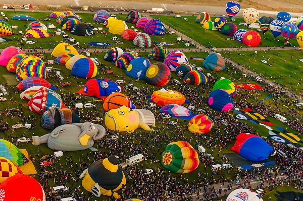 Aerial view of hot air balloons preparing to take off at Balloon FIesta Park during the Albuquerque International Balloon Fiesta, Albuquerque, New Mexico USA.