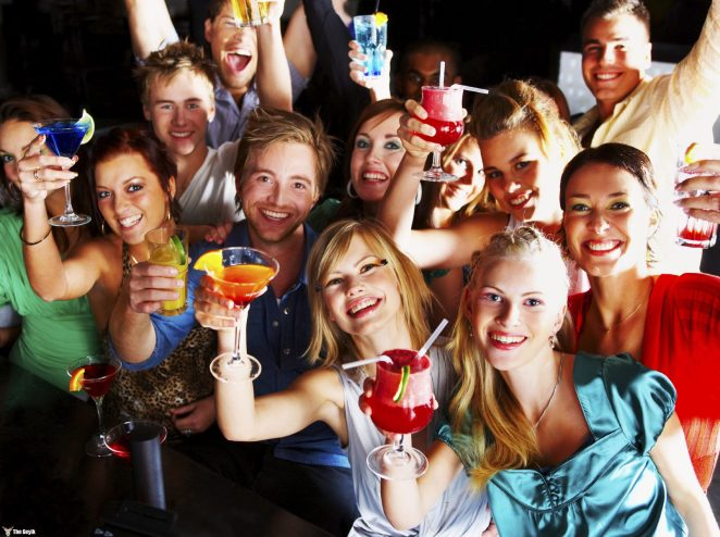 A group of young people enjoying cocktails