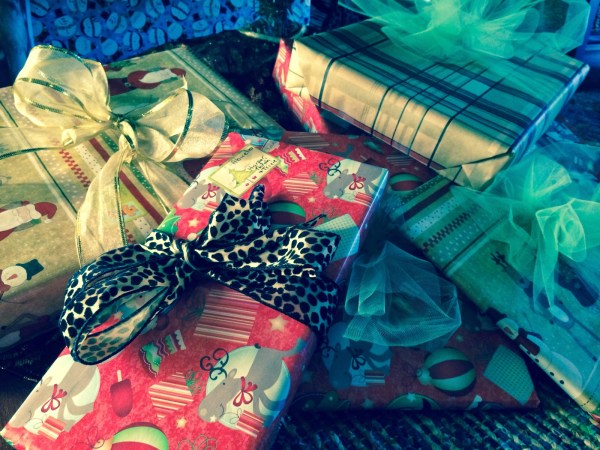 Tips for hosting a gift wrapping party. Have fun with your friends AND get those gifts wrapped!