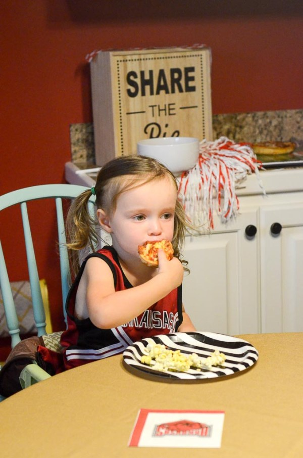 Little girl eating pizza on game day - Red Baron Pizza - The Gifted Gabber