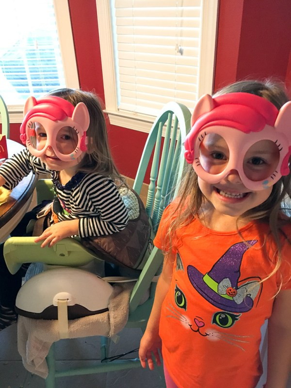 Two little girls wearing The Little Pony Movie glasses from their Happy Meals - A Look Back at My Time as McDambassador