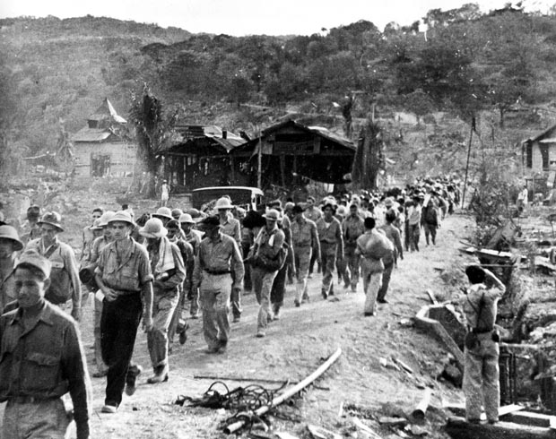 American and Filipino prisoners of war captured by the Japanese are shown at the start of the Death March after the surrender of Bataan on April 9 near Mariveles in the Philippines in 1942 during World War II. Starting on April 10 from Mariveles, on the southern end of the Bataan Penisula, 70,000 POWs were force-marched to Camp O'Donnell, a new prison camp 65 miles away. (AP Photo)
