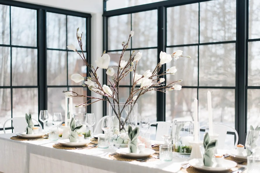 Easter table setting with bunny napkins and faux magnolia stems