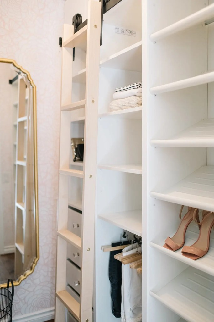 A rolling library ladder completes this DIY custom master closet makeover
