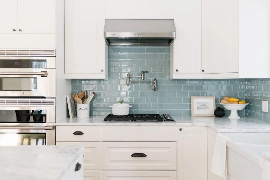 A custom kitchen with glass backsplash tile
