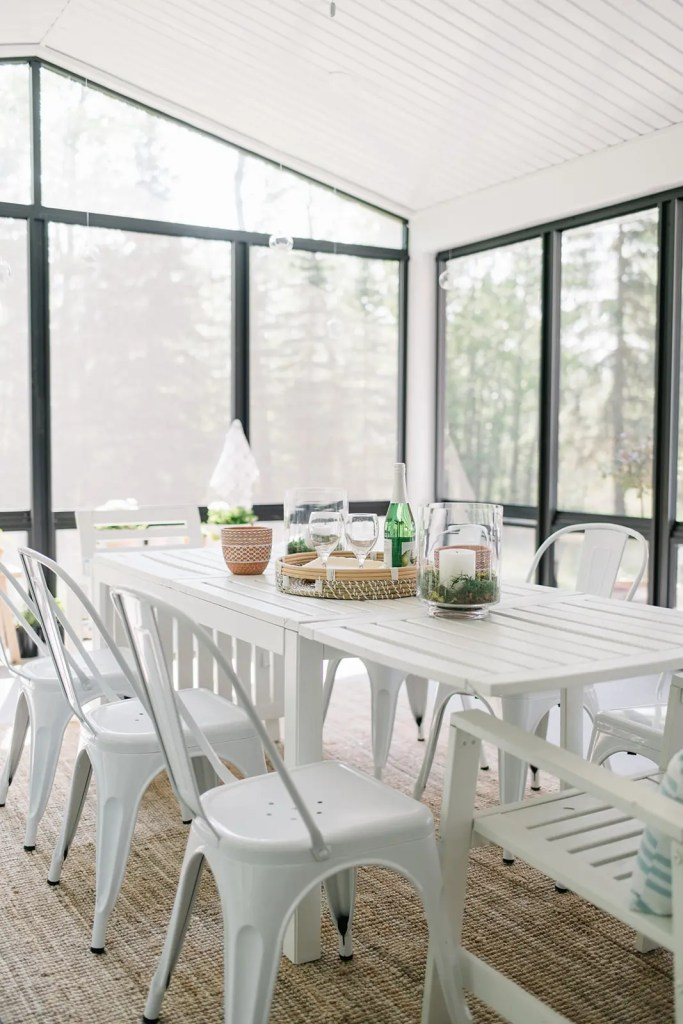An outdoor dining area set up in the sunroom at The Ginger Home.