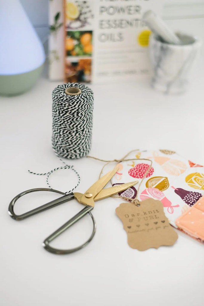 Scissors and string ready to wrap a summer gift or essential oil package