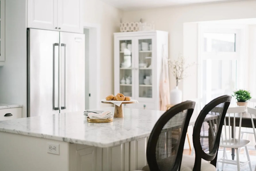 kitchen with pedestal of donuts on island