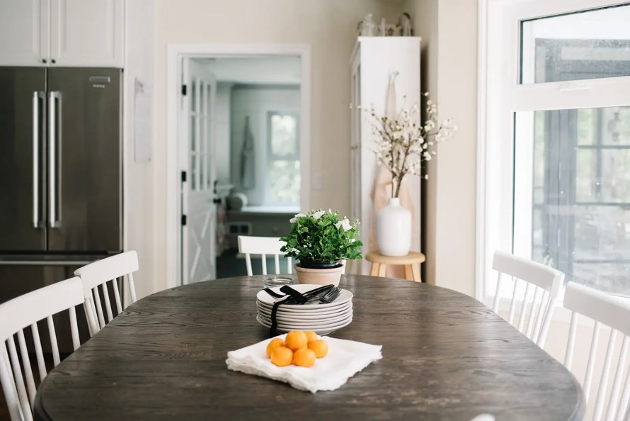 Dining table with stacked plates and oranges