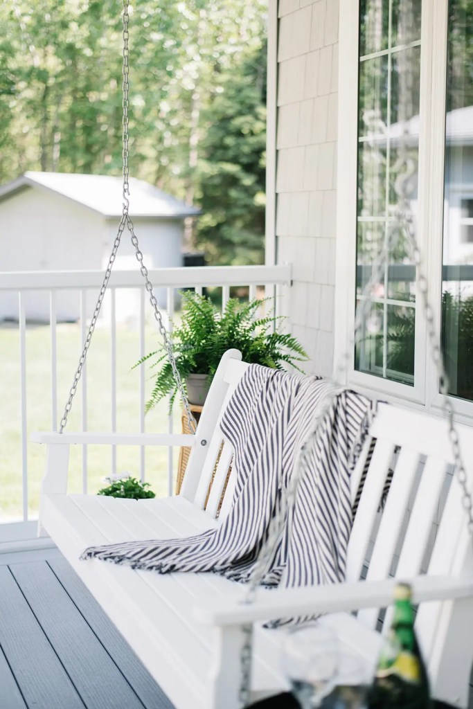 A front porch swing makes a relaxing place to sit in the summer.