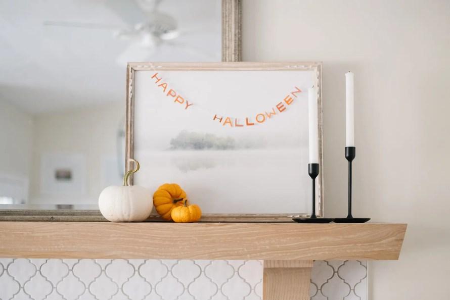 mini happy halloween banner strung across an art print