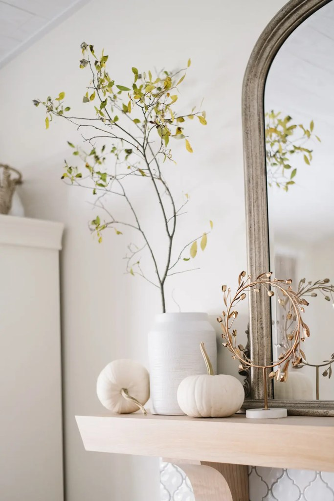 White pumpkins transition this mantle from fall to Halloween