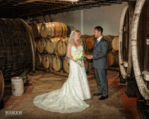 Wedding photos in the wine cellar – Photo credit Baker Photography