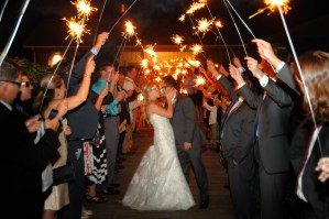 Reception procession with sparklers on the wisteria walkway - Photo Credit Baker Photography