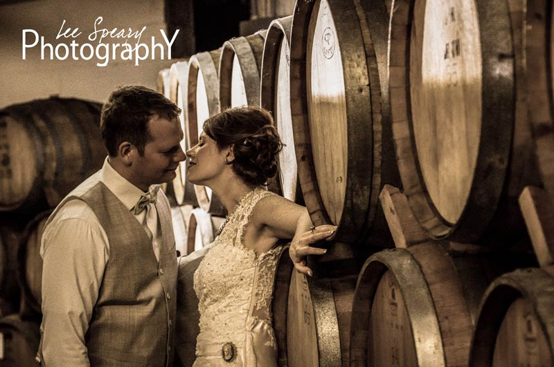 Bride & Groom in Wine Cellar