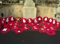 Laying the Girlguiding poppy wreath at the local cenotaph.